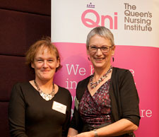 Professor Fiona Ross received her Queen's Nursing Institute award from the organisation's chair of trustees Kate Billingham CBE.