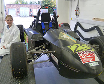 Sabine Brosch with the car created by members of Kingston University's e-racing team.