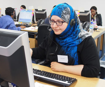 Biomedical science student Farhat Bibi answers inquiries from Clearing hotline callers.