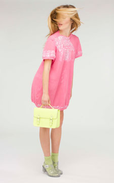 Krista Hendriksen spent hours painstakingly sewing sequins on the short, pink shift dress in her collection..