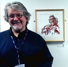 Senior lecturer in mental health nursing Chris Hart next to his likeness created by Alban Low.