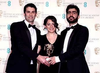 James Walker, Sarah Woolner and Yousif Al-Khalifa with their BAFTA. Photo by: Ray Tang/REX