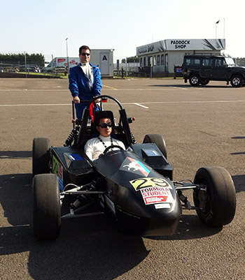 Drivers Andy Ng (sitting) and Chris Grzebien (behind)