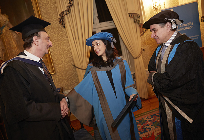 Hadia Tajik receiving her honorary degree from Professor Philip Spencer (L) and Professor Julius Weinberg, Kingston University Vice-Chancellor, in Oslo.