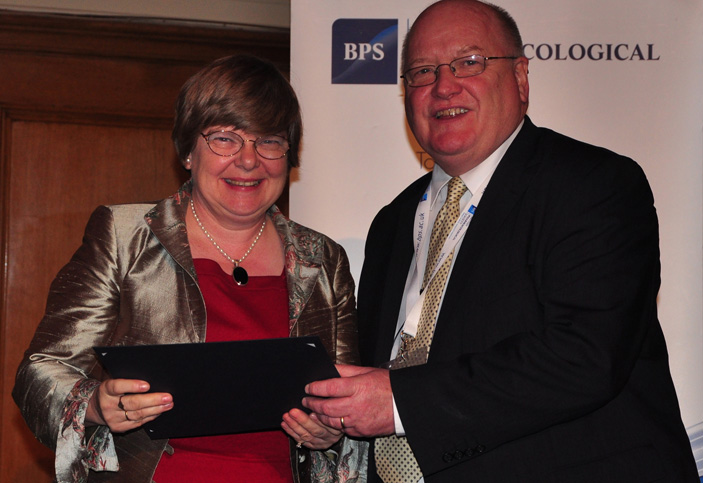 Professor Edith Sim, left, is congratulated on her outstanding contribution to scientific research by British Pharmacological Society President Professor Philip Routledge.