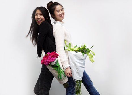 Easthetic team members Daisy Wang (left) and Winnie Lao (right) demonstrate the Pozzy.