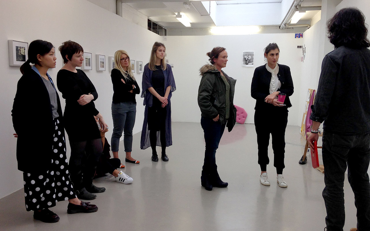 Group crit at an exhibition