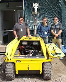 Kingston academics, from left, Christopher Madden, Dr James Orwell and James Annesley have played a key part in creating the moon buggy which is able to detect threats soldiers might encounter in a war zone.