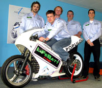 Engineering students (from left to right) Dean Goldsmith, Michael Payne (sat on the bike), Sean Whittaker, Alex Jones-Dellaportas and Gonzalo Carrasco with the green bike.