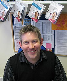 Matthew Osbourn, Kingston University's Web Manager with sample prospectuses
