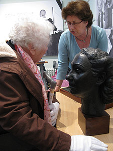 Sheila Burden, left, from the Kingston Association for the Blind, learns more about sculptor Dora Gordine's work from the curator of Kingston University's Dorich House Museum, Brenda Martin.
