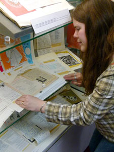 University archivist Katie Giles with the Cary Ellison theatre programme collection.