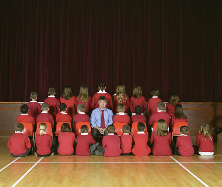 Children from Mayflower Primary School facing away from the camera for a photo with head teacher Steve Springett.