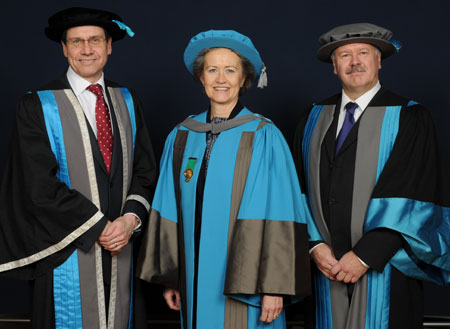 Pro Vice-Chancellor for Corporate Affairs and University Secretary Neil Latham, left, and Professor Tim Ellis, right, congratulate Elizabeth Sparrow on her honorary degree.