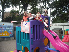 Youngsters at Kingston University Nursery celebrate their outstanding report.