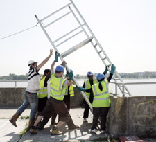 Kingston University Architecture students hoist the ladder into position