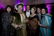 Henry VIII and Catherine Howard lookalikes with delegates at the national conference gala dinner at Hampton Court Palace