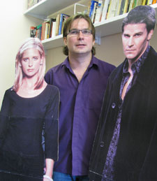 Professor Pateman has cardboard cut-outs of Buffy and Angel in his office.