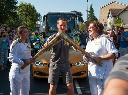 Reda Vida Gani passed the torch to Margaret Loveridge before it continued its journey into Kingston town centre.
