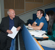 Greg Dyke, who ran the BBC from 2000 to 2004, talks to Kingston University journalism students following his lecture.